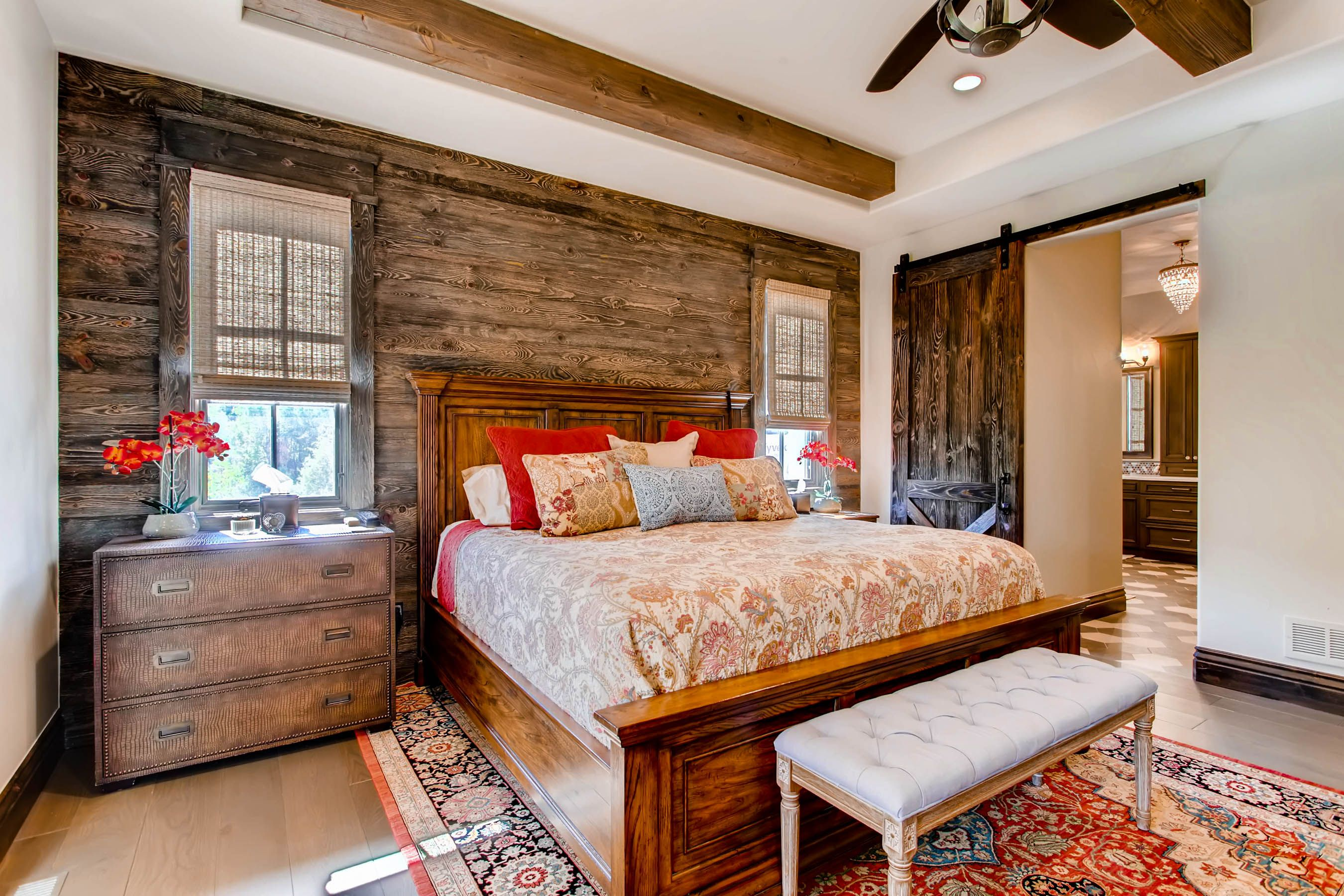 Rustic bedroom with weathered wood accent wall, exposed ...