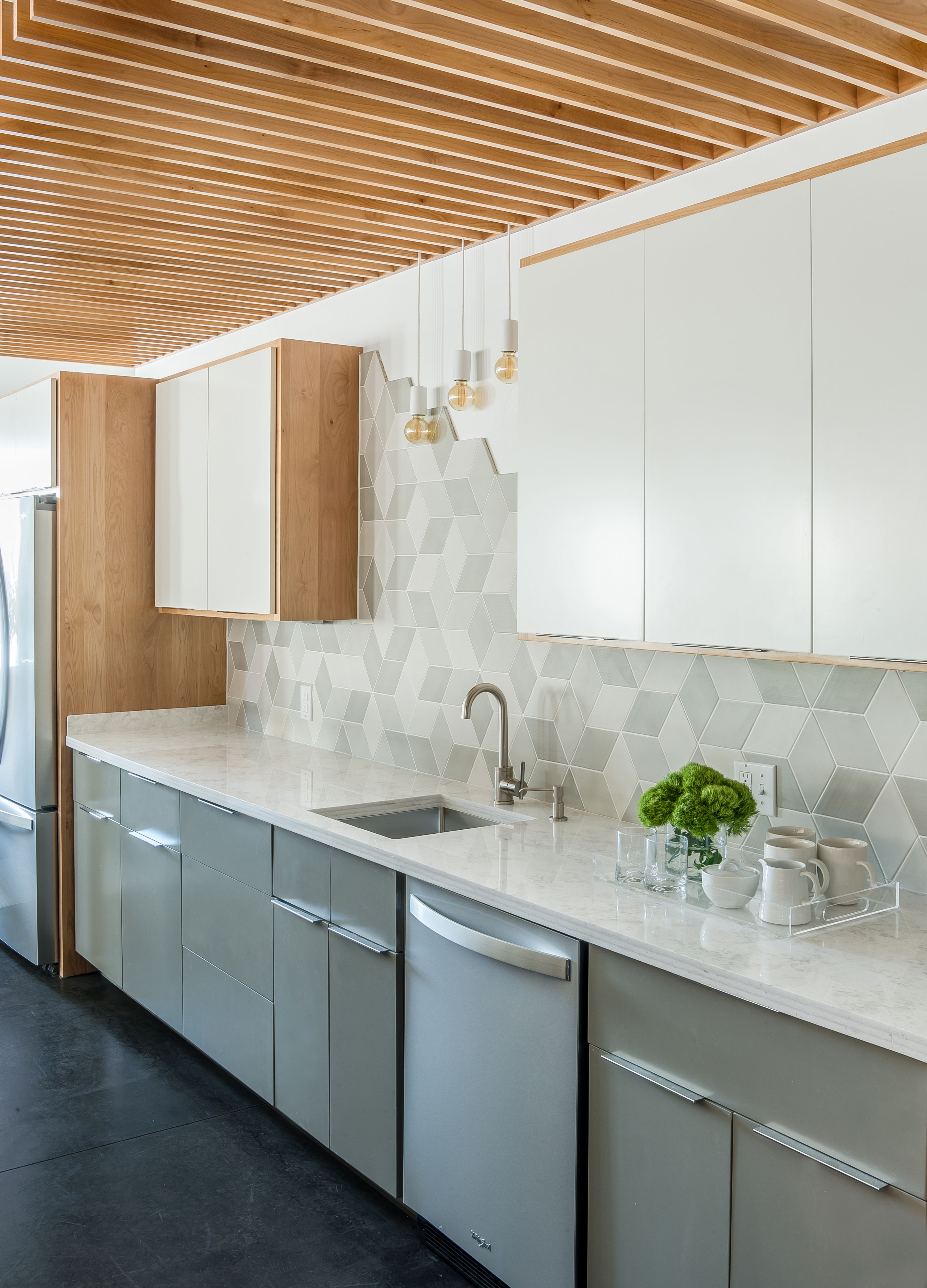 give a simple kitchen a shot of visual interest with an unfinished tile backsplash on kitchen ideas simple id=53327