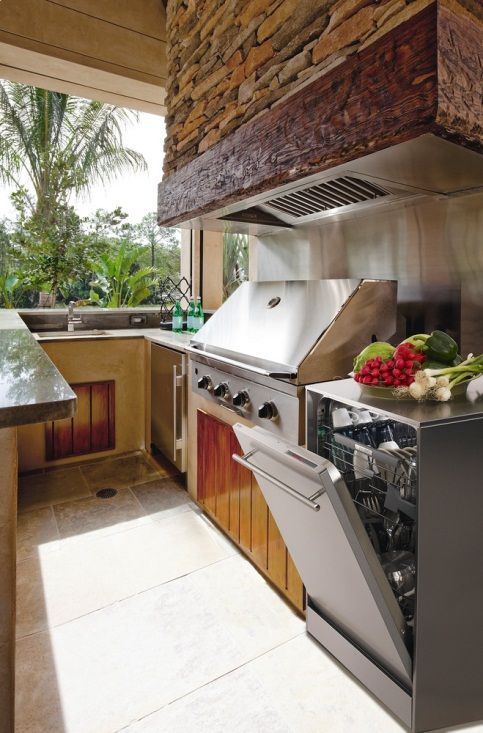 Whoa! Have you ever considered putting a dishwasher OUTSIDE? If you do a lot of outdoor parties and barbeques, you might want to! The Outdoor Entertainer's Dream Kitchen
