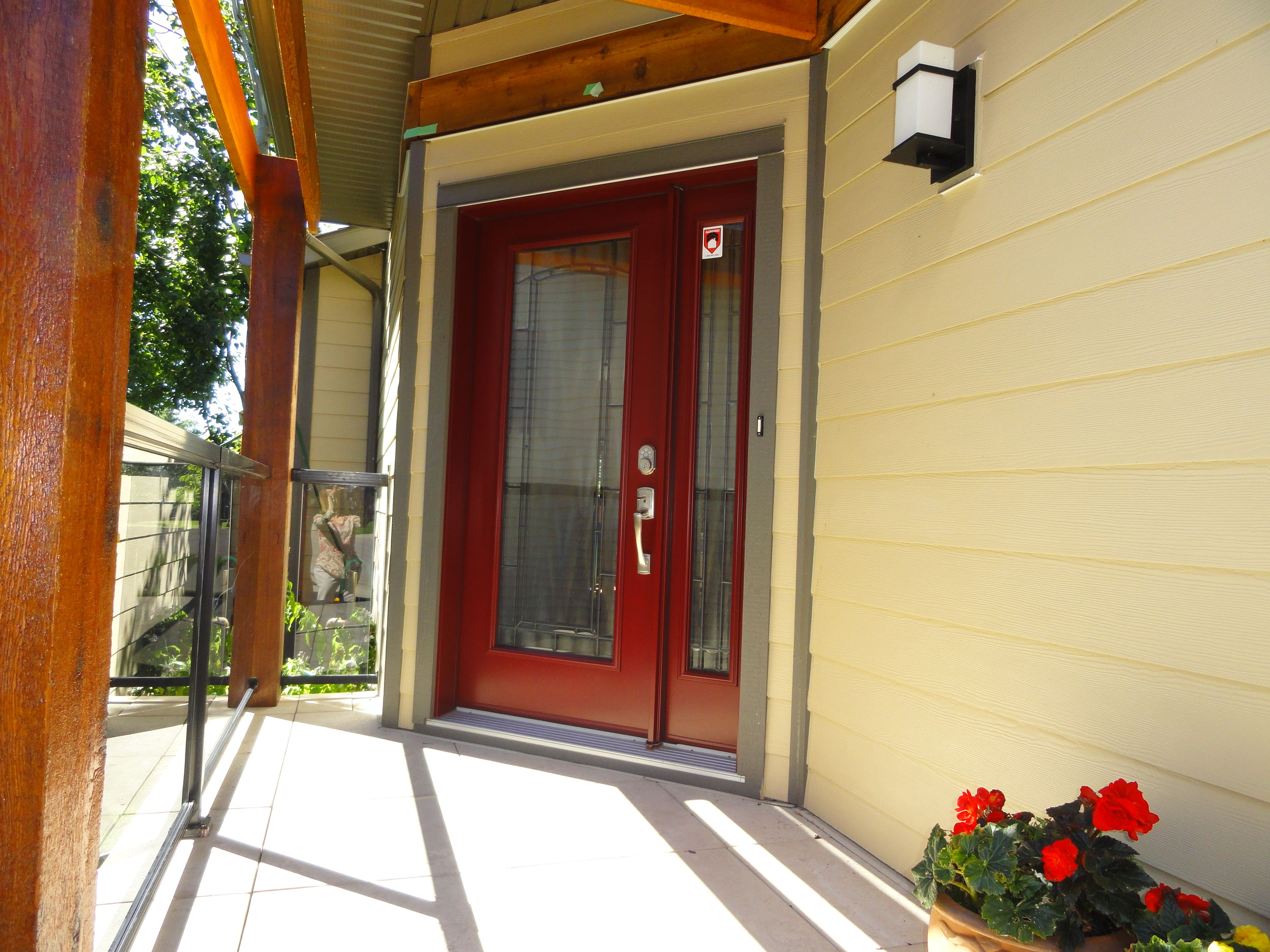 Adelaide glass insert by trimlite portatec red colored single entry door with sidelite Exterior doors installation calgary