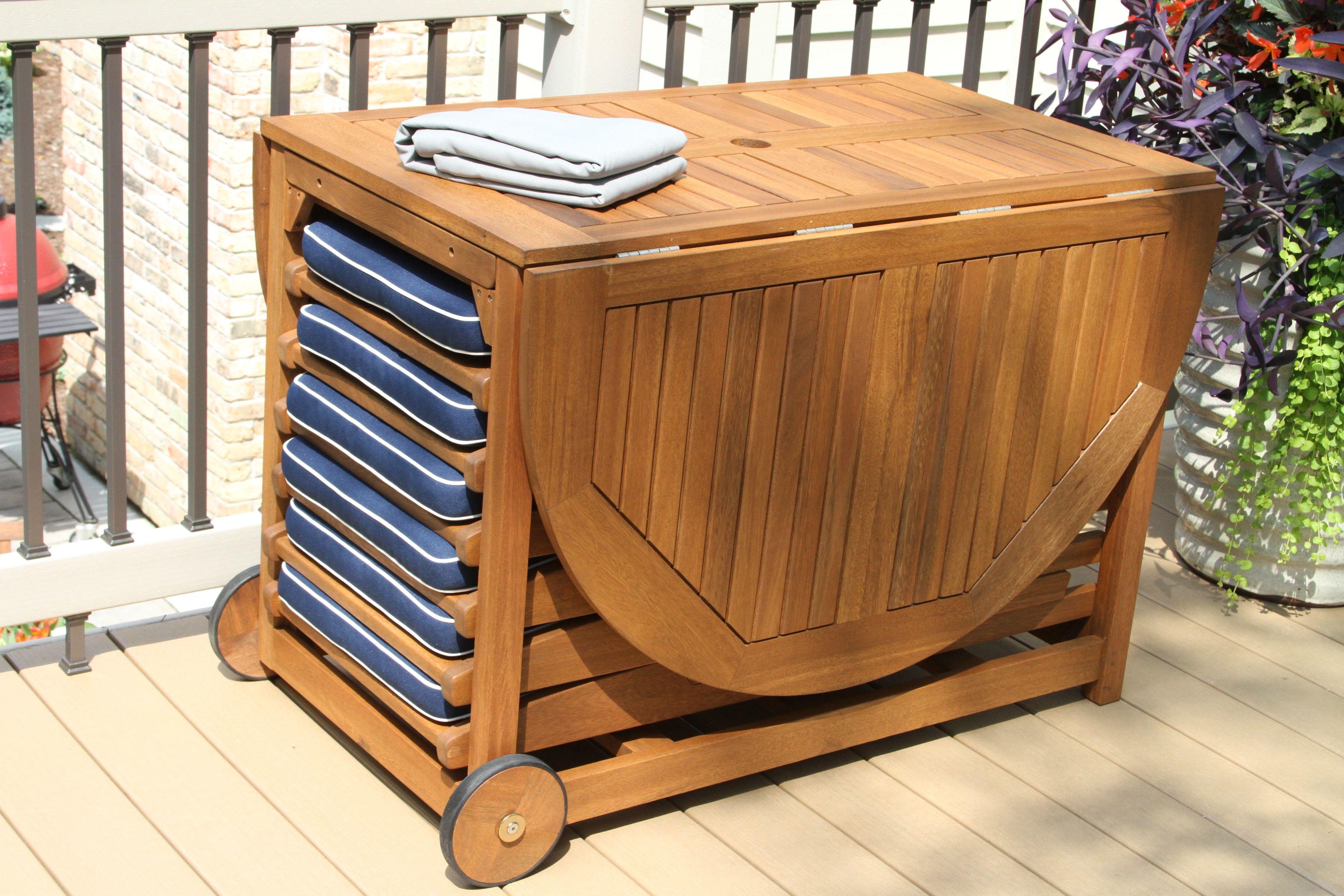 hardwood table set with blue cushions