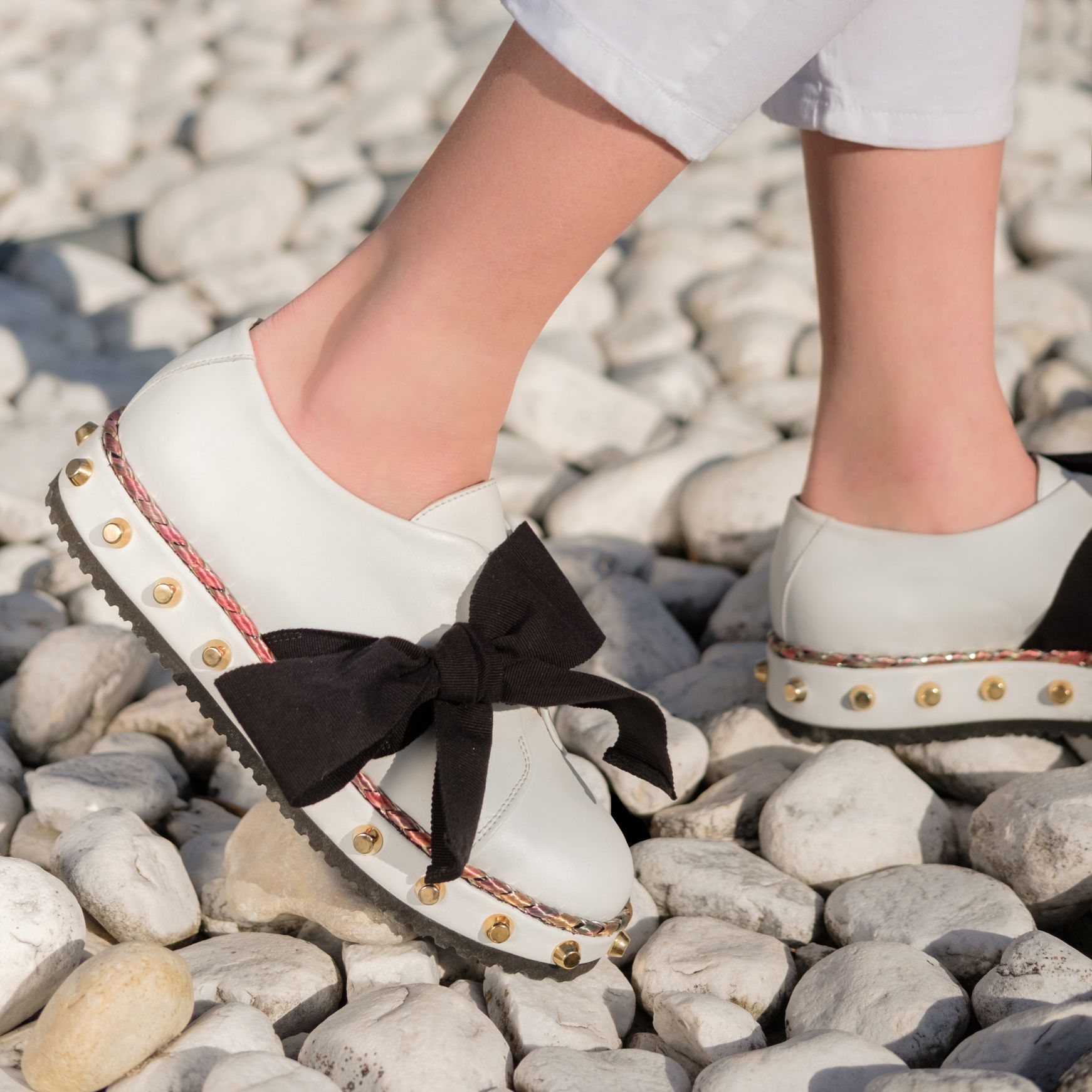 A meswear mainstay reimagined with whimsy, wit and a sprinkling of studs. Step into the brogue with bow. #FollowtheRibbon #agl #aglshoes #brogue #white #bow #ribbon