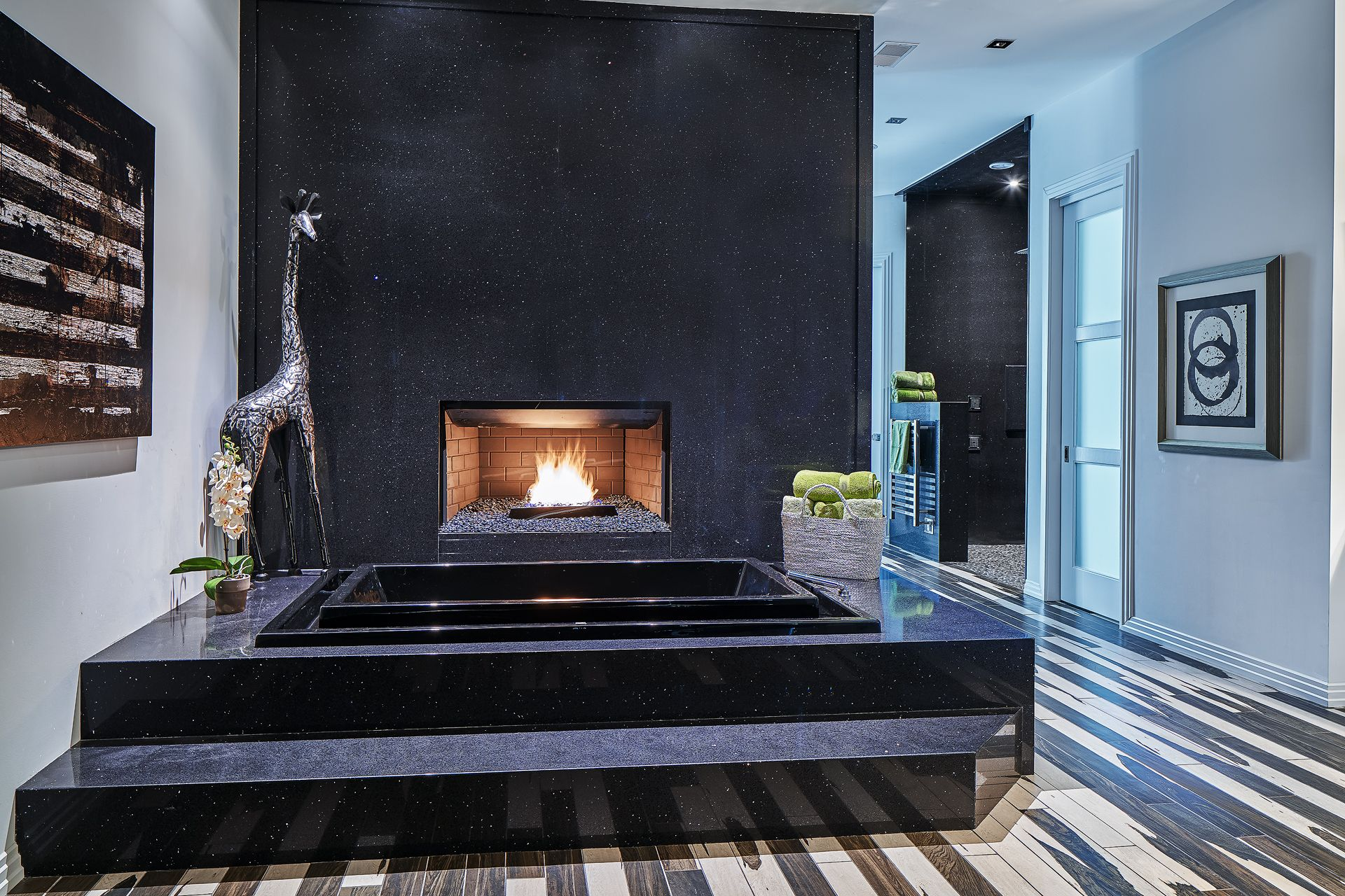 Another view of the magnificent master bath tub and fireplace! Master  shower is off to the right. Sparkling Black Quartz wall and tub surround.