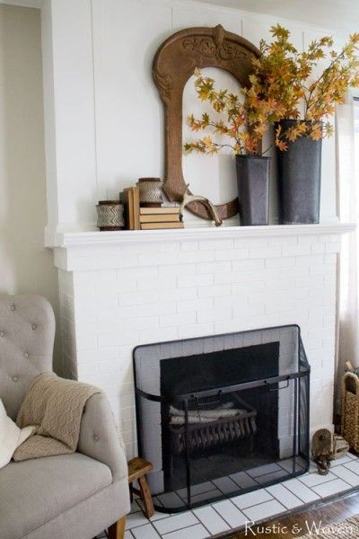 simple-fall-mantel-with-tin-buckets-leafy-branches-and-metal-hurricanes