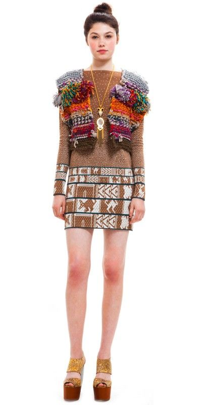 I like the texture element to this vest--if it was made with pom poms and asian elements, and was bolder and less knitty.