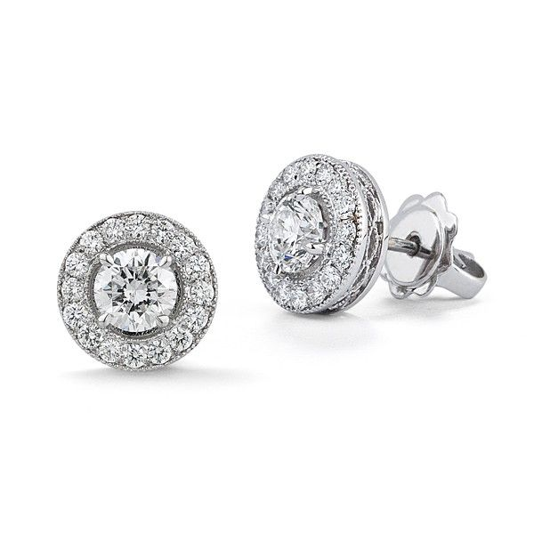 Not My Mom's Studs -   While we love the classic 4 prong diamond stud earrings, sometimes we just need a little extra glamour in our lives. Our new classic diamond studs include some extra sparkle around the center diamonds. A total diamond weight of about 1.40ctw that will look spectacular on your ears.  Available in 14kt white and yellow gold