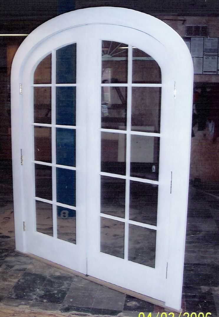 Arch top doors; custom made/built wood; interior, exterior, entryway Arched Top Interior Double Doors on