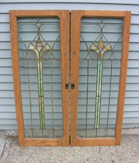 "2 1920's Leaded & Stained Glass Bookcase Door / Window. Each door measures 47"" by 18"" and the glass only is 42"" by 13""."