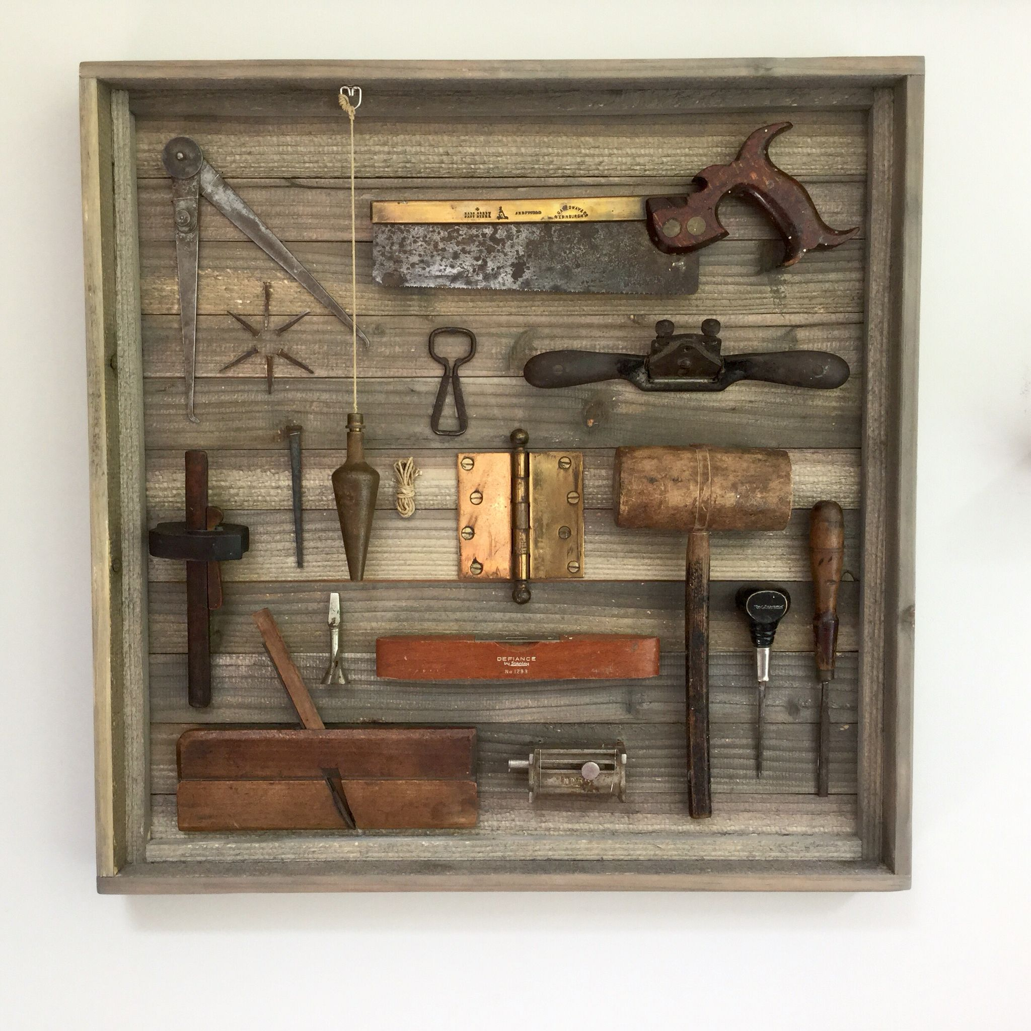 In the kitchen antique wrenches are used as cabinet door handles and - Vintage Tool Display
