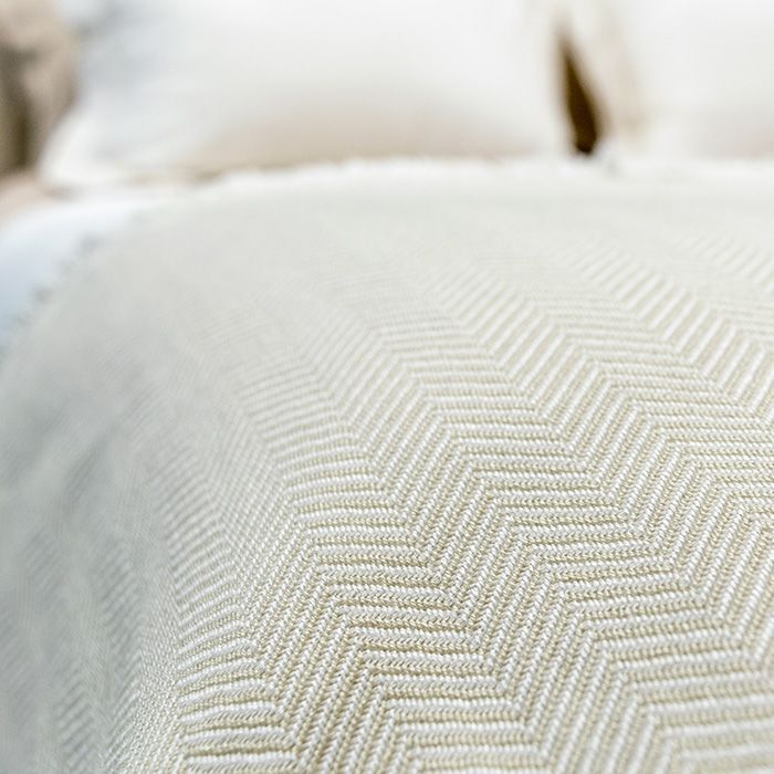 Inspired by hotel living, the Herringbone Throw woven blanket is artfully crafted & designed for use in every season.  The classic Herringbone Throw features a natural fringe which accentuates its elegant champagne & ivory herringbone pattern.  Made in the USA & crafted from 55% Tencel +Plus™, this luxurious throw is silky & soft making it the perfect accessory for snuggling up in your designer bedding.  Contents: 55% Tencel Plus, 45% Cotton  Width54'' Length76'' Hem Width1''. $169.98