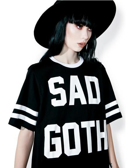 Killstar Sad Goth Hockey T-Shirt cuz you rep sadness in a major way, babe. This dope oversized tee features a comfy black construction, white trim, varsity stripe details, and bigass bold lettering on the chest reading 'SAD GOTH.'
