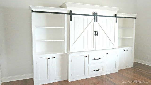 sliding barn door white entertainment unit farmhouse style lake house style family and the lake house wwwfamilyandthelakehousecom - White Entertainment Center Wall Unit