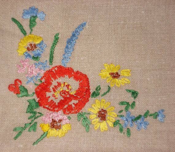 This beautiful Vintage cushion cover, is embroidered with Cotton flowers of poppy with sunflowers and holly hocks, on biscuit coloured linen, with