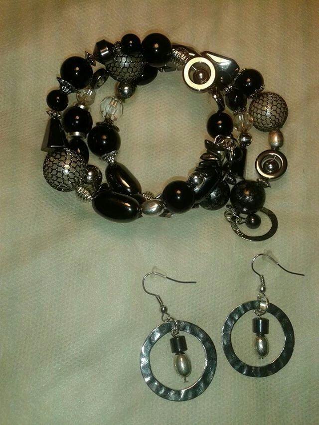Black memory wire bracelet and earrings.