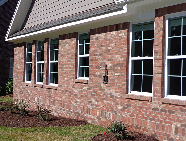 These Windows Are Framed By A Soldier Course Water Table And Brick