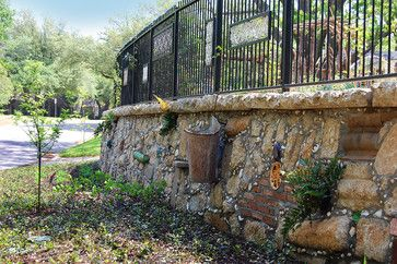 Seashells Pottery And Small Toys Into The Mortar Joints The Reclaimed Concrete On The Wall Cap Traditional Landscape Good Neighbor Fence Outdoor Living Decor