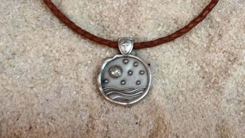 A woven brown cord version of the Moon and Stars necklace