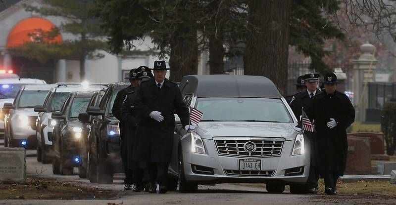 Police escort the hearse into Oakridge Cemetery in Hillside on Wednesday for Bloomingdale Police Officer Raymond Murrell, who died in a crash responding to a call of retail theft.  Bev Horne | Staff Photographer