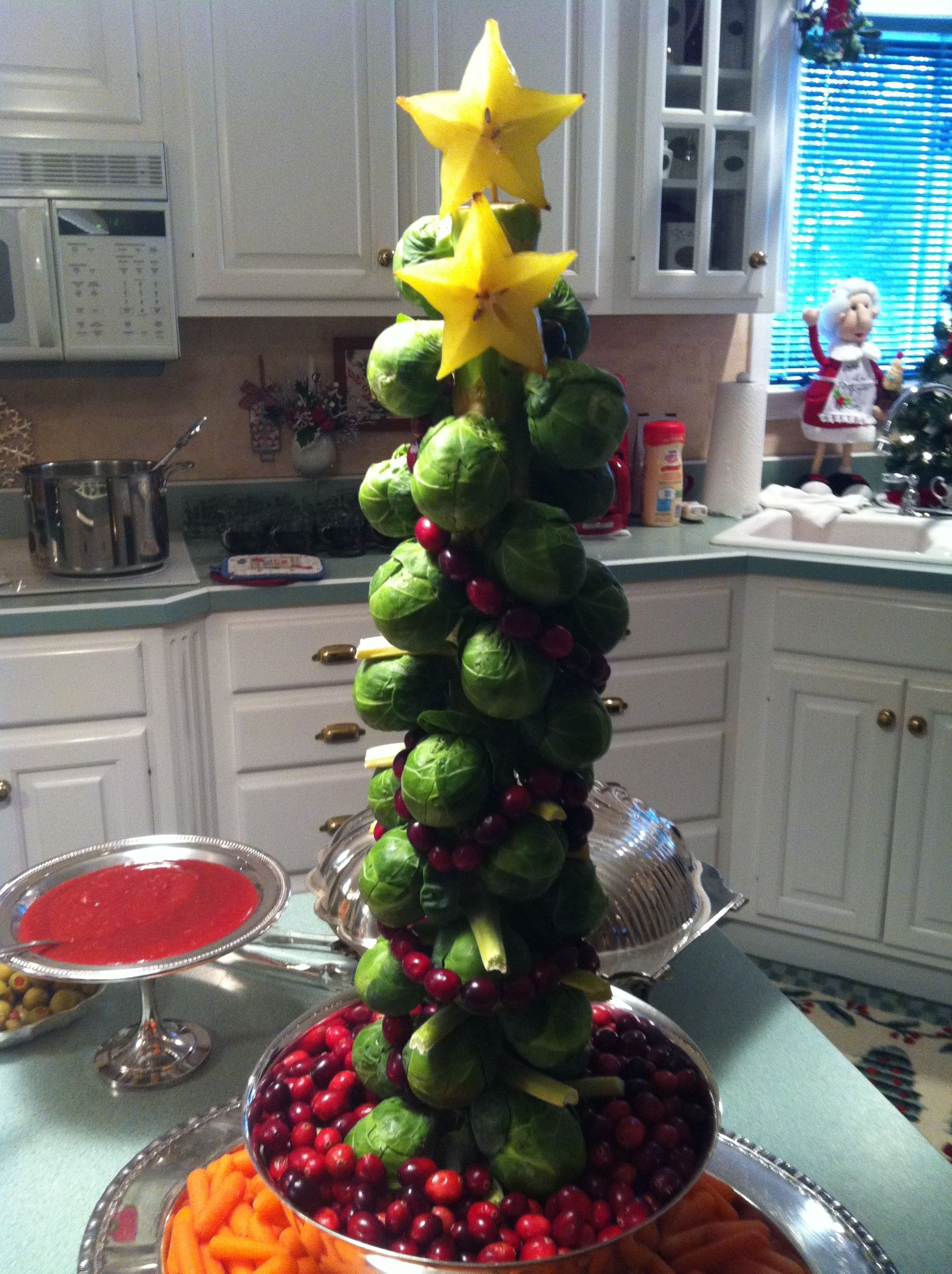 brussels sprout christmas tree put a brussels sprout stalk in a base with water and decorate with cranberry garland use a star fruit slice as the tree - What Do You Put In Christmas Tree Water