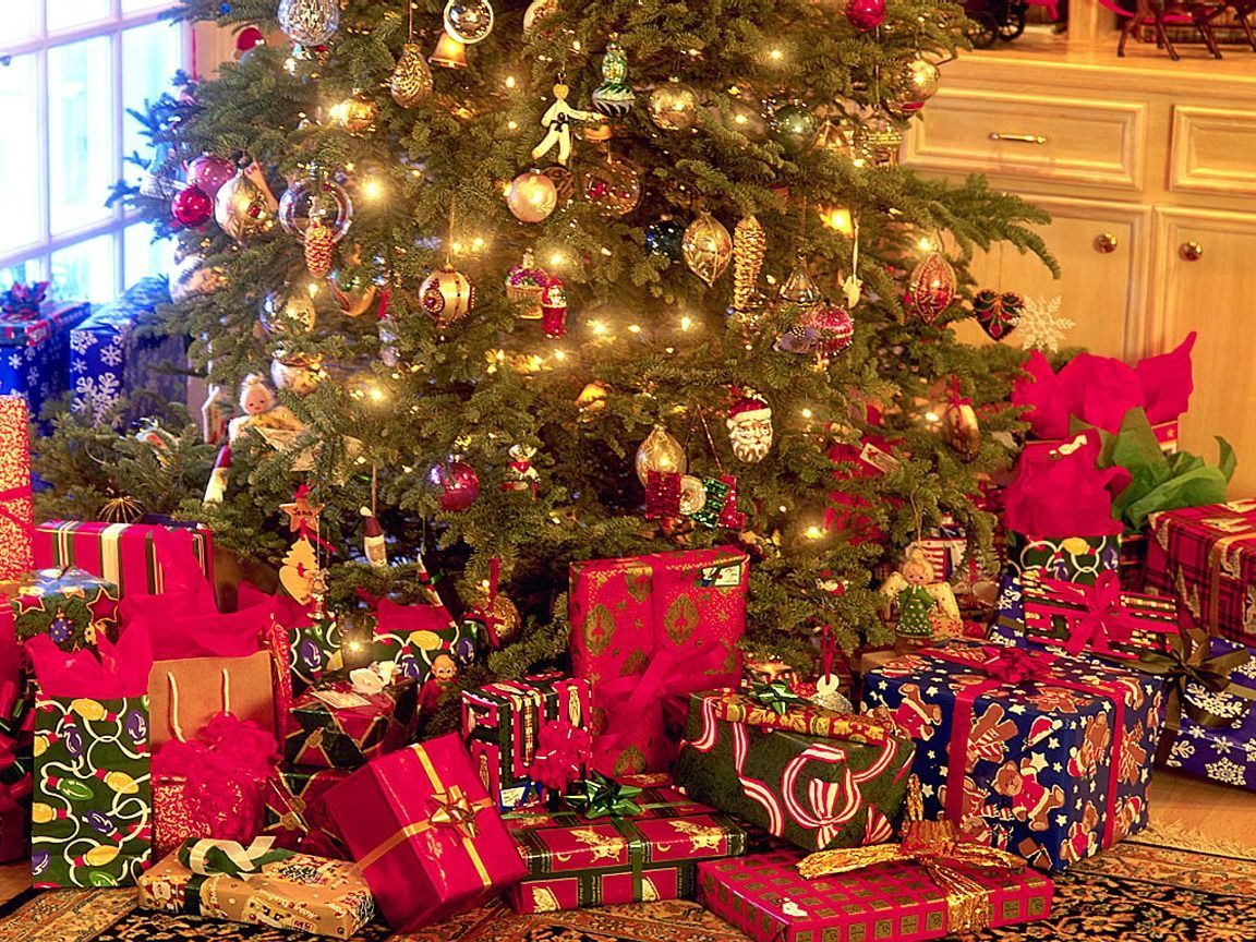Image result for images of a christmas tree with gifts