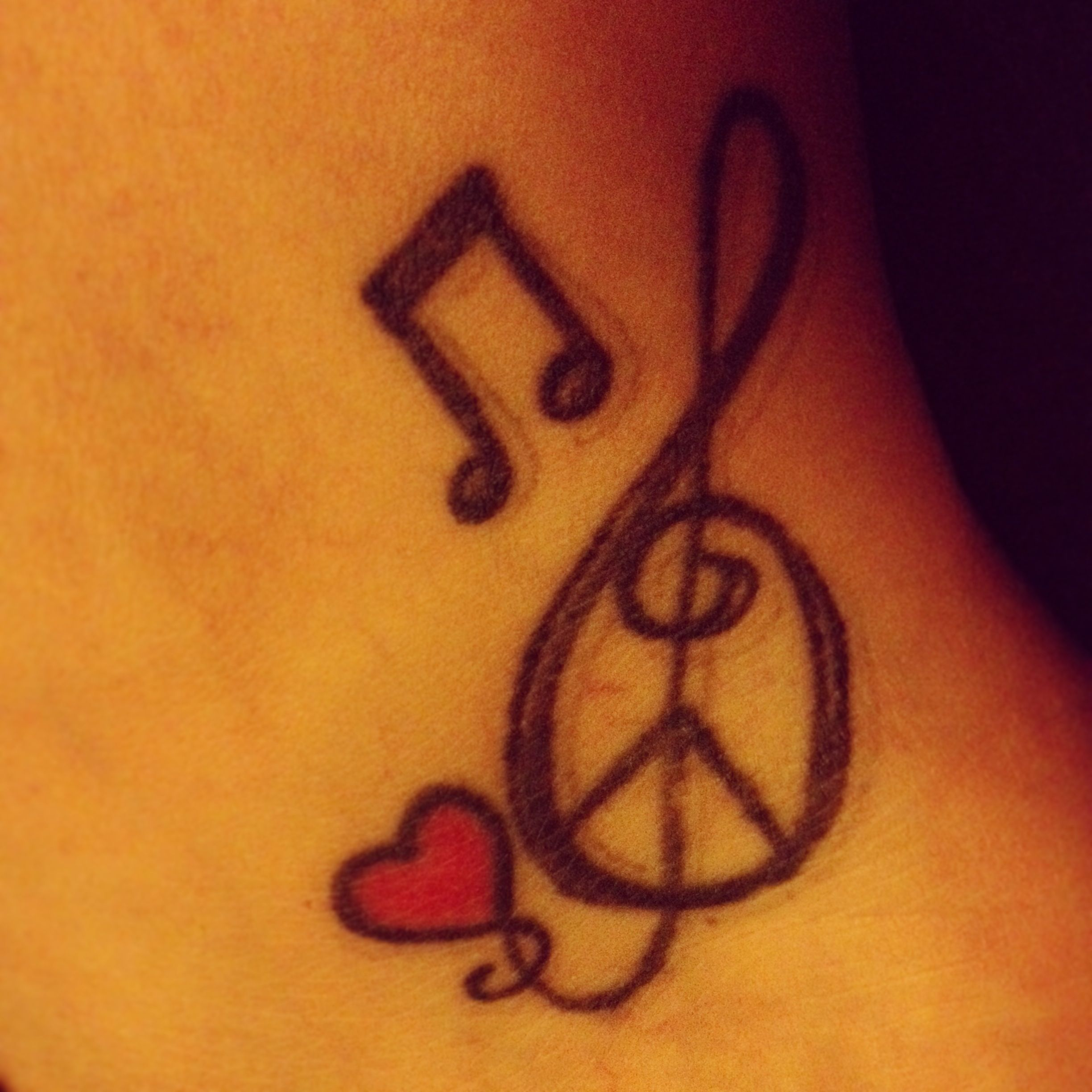 My ankle tattoo. Peace, love, music. ❤