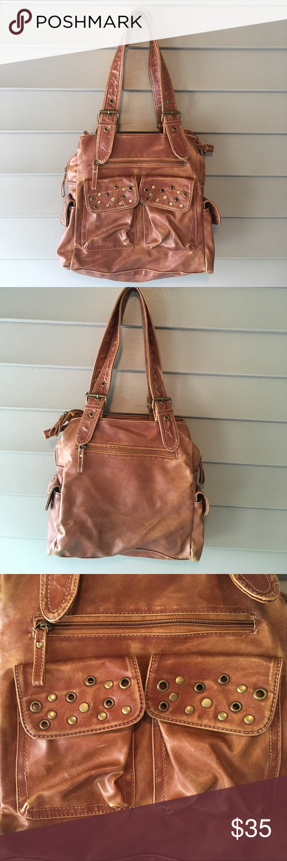 Faux Leather gold grommet double strap handbag Beautiful neutral brown Faux leather bag with gold grommet details. Plenty of pockets., several the perfect size for you phone. Double zip for inside with so much room. Handbag looks really chic!! Bags Shoulder Bags