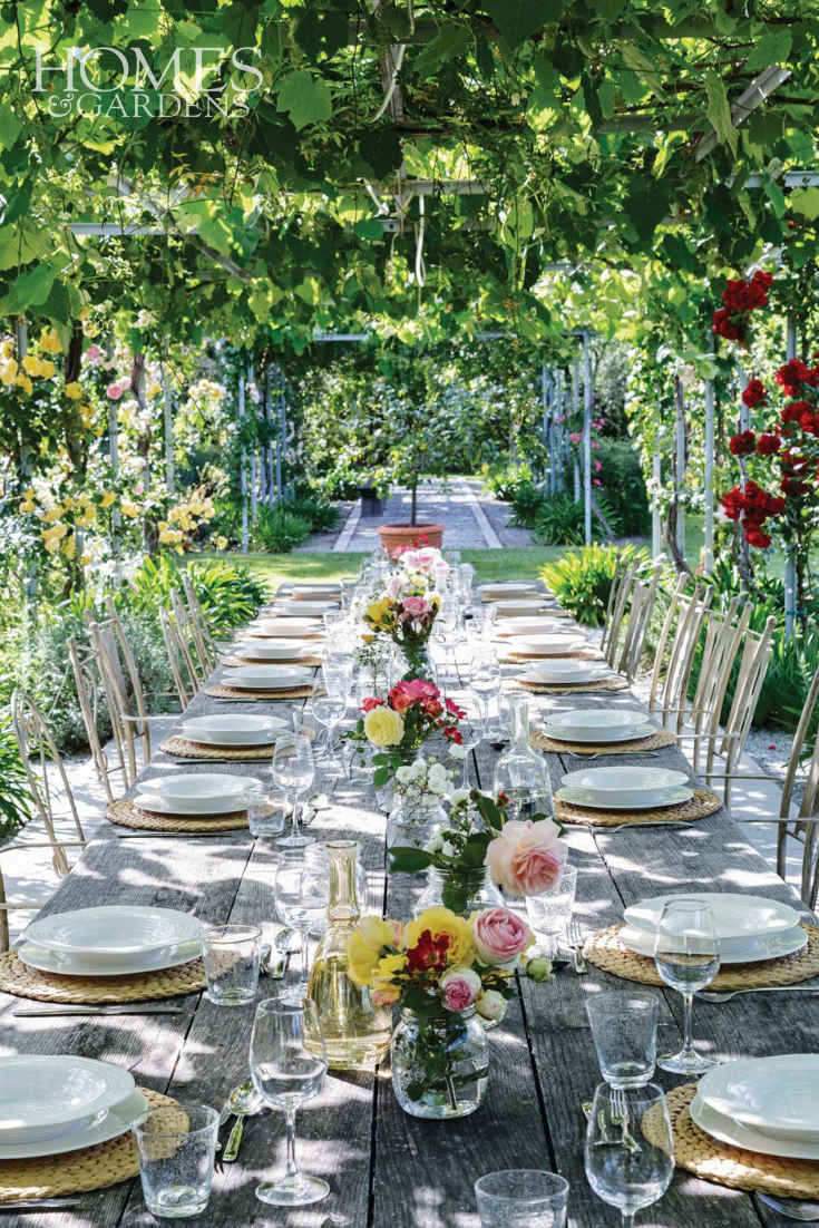 This Outdoor Dining Table Is Covered From The Tuscan Sun With
