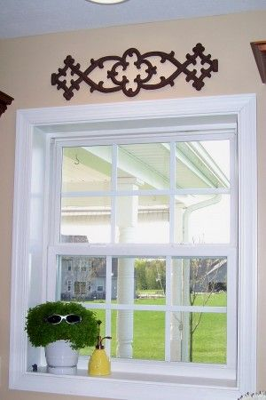 Iron Above Window Don T Care For This Particular Piece But It Is An Idea To Finish Off A Window Wit Above Window Decor Window Decor Fabric Window Treatments