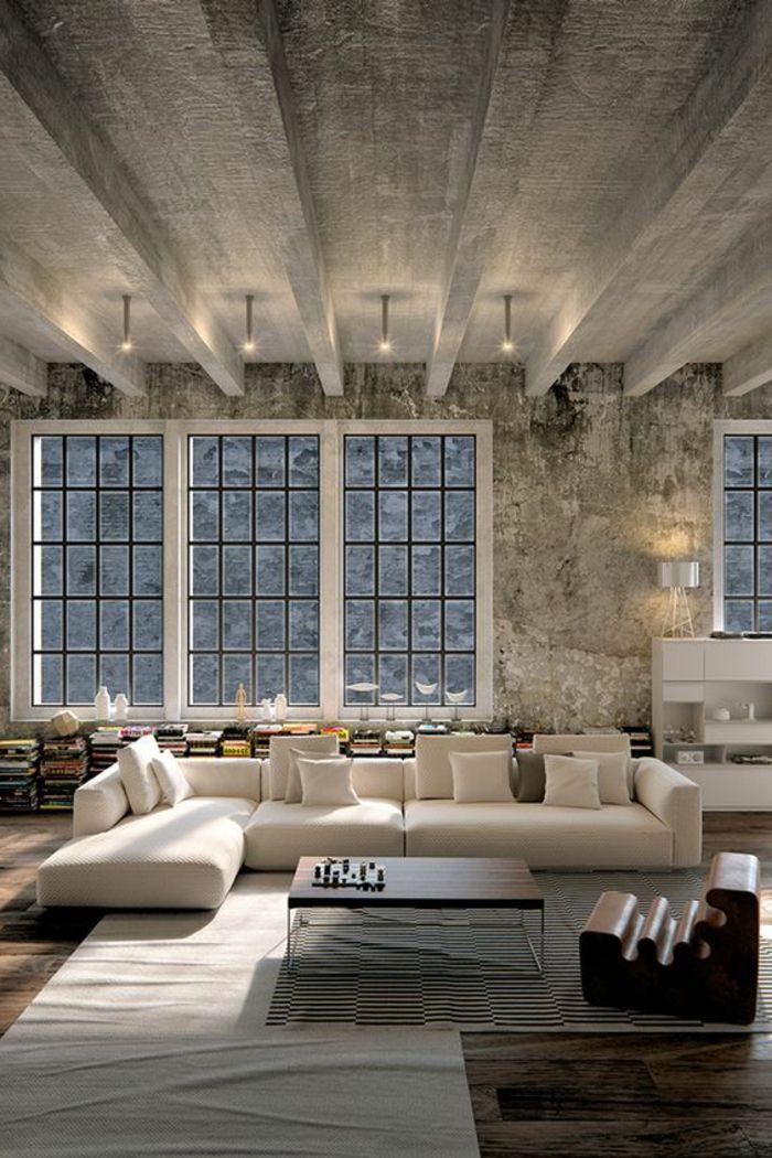 ide deco salon plafond en bton style industriel sofa couleur claire livres au sol