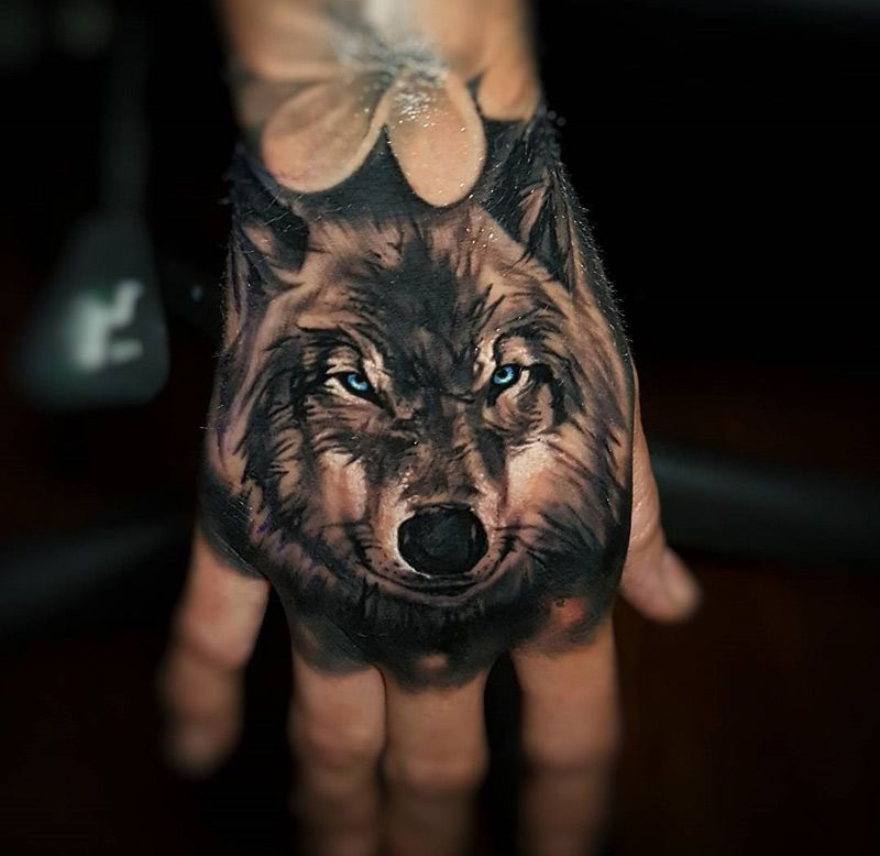 Mischievous Wolf With Milky Blue Eyes Done On Girl S Hand By Tyler Malek An Artist Based In Salem New Hampsh Hand Tattoos For Guys Hand Tattoos Wolf Tattoos