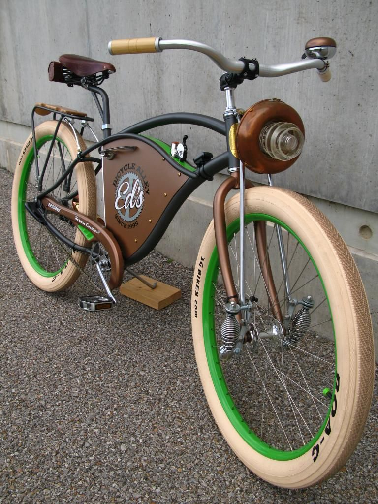 Cruiser Bike With Some Neat Wee Suspension Springs On Lower Front Forks And An Unusual Light Setup