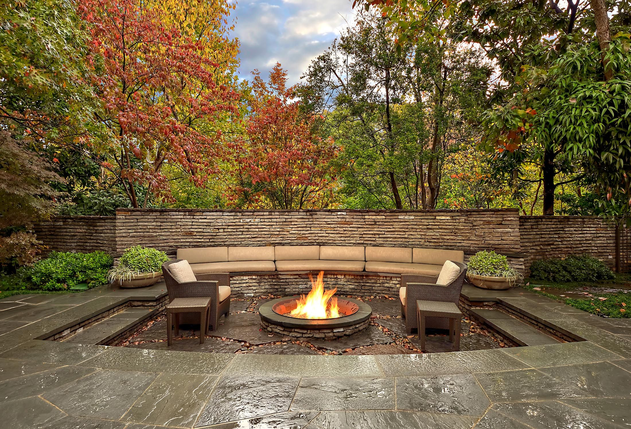 fire pit made from old sugar kettle seating area is recessed to