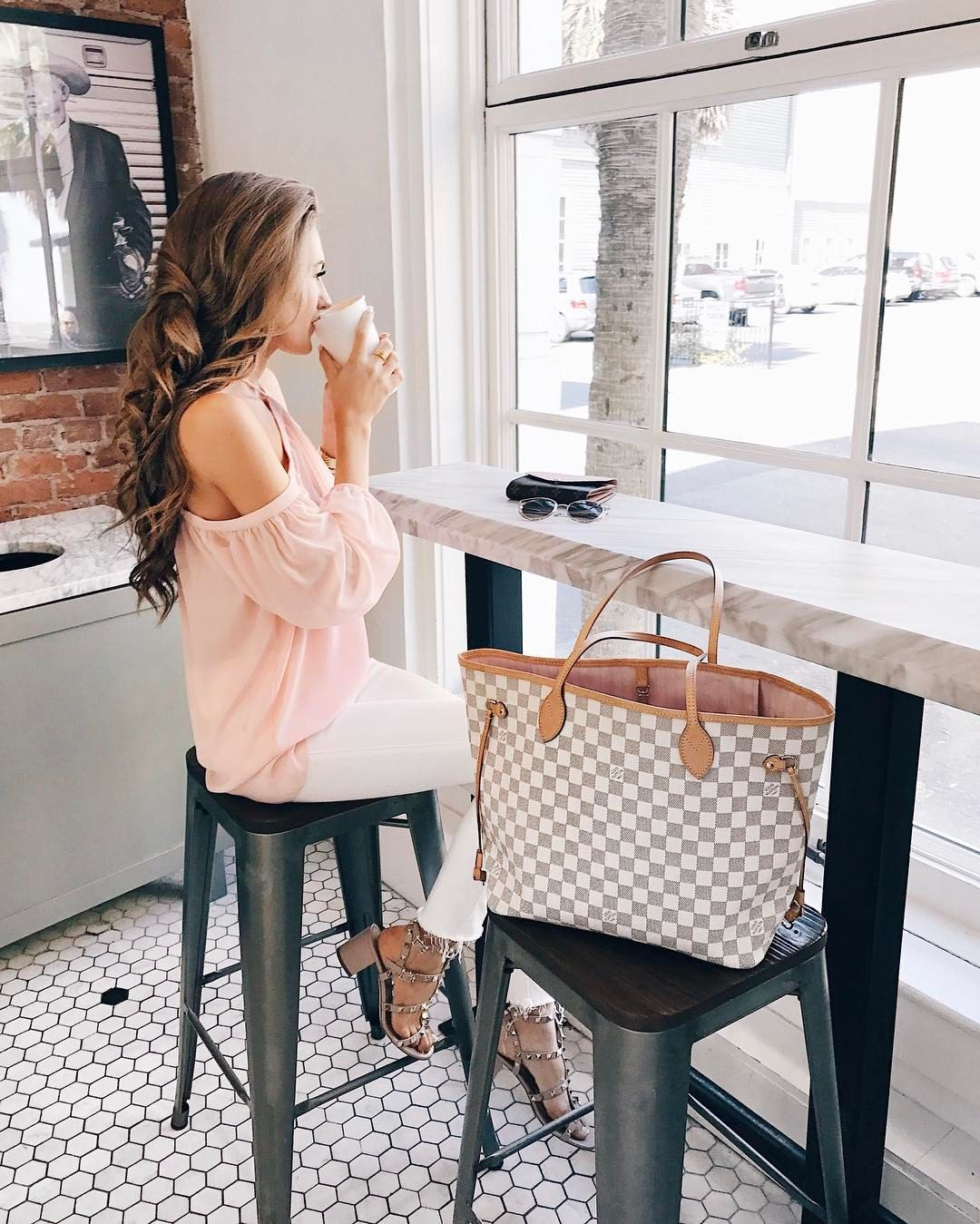 8736d4e7d Spring weekend cafe outfit - pink off shoulder top, white jeans, studded  sandals, and Louis Vuitton Neverfull tote bag