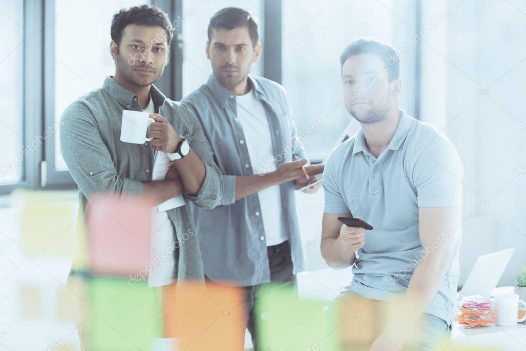Selective Focus Young Multiethnic Businessmen Looking