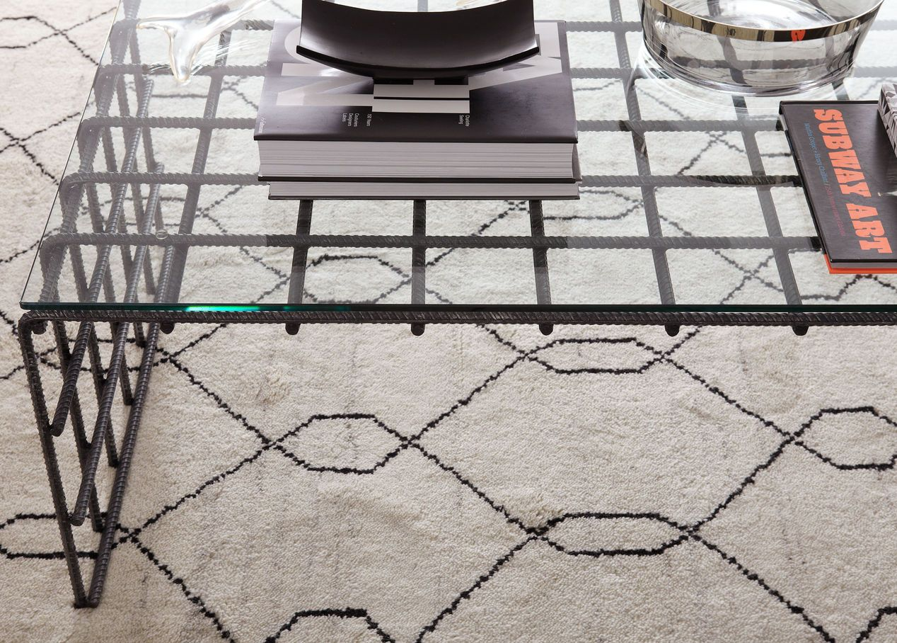 Update Your Room With Our Beautiful Rugs And Coffee Tables Shown
