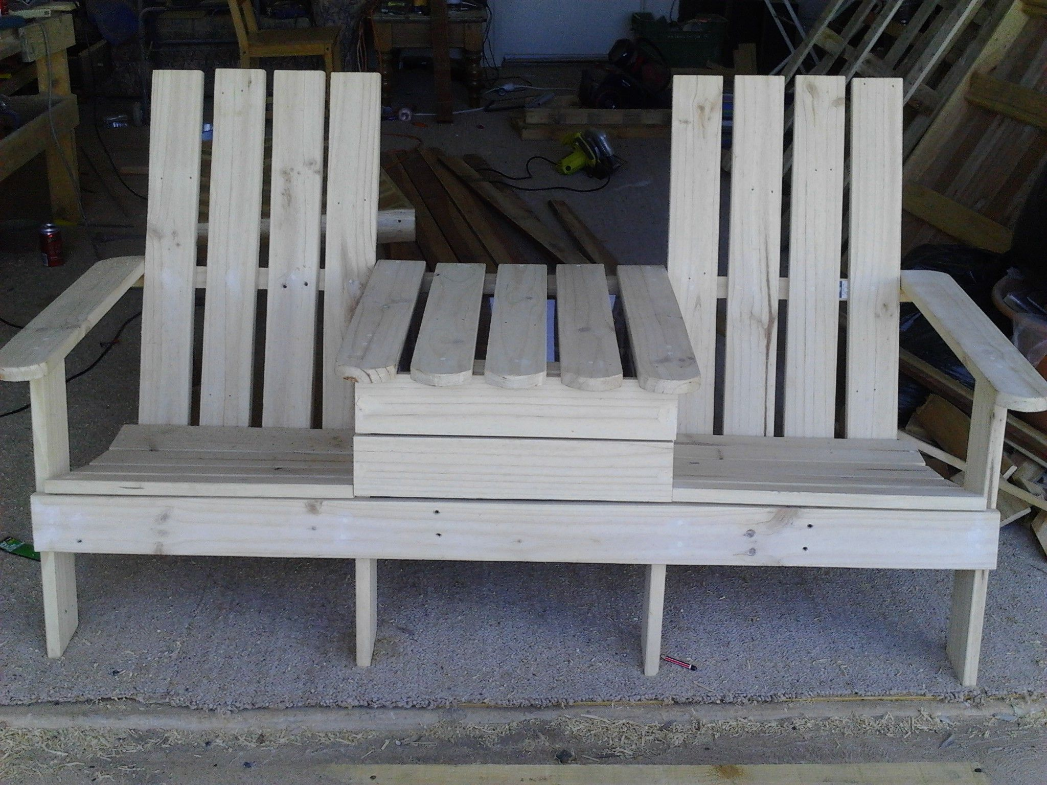 Made from pallets. Includes a beer cooler in the middle. Submitted by: Steve Fryar !…