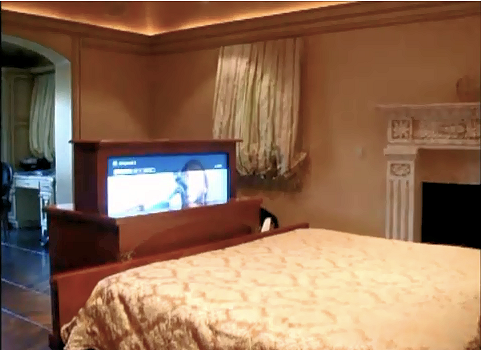 by tech junkies simi valley hidden tv at the foot the bed pops up out of custom built cabinet this lift also spins 360 degrees so itu0027s viewable from the