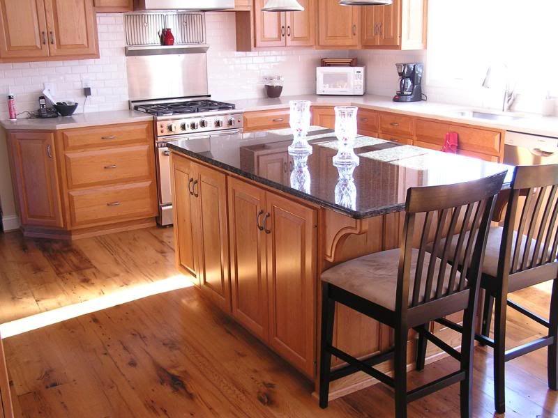 I have 19 oak cabinets...... I thought wood floors would make it ...