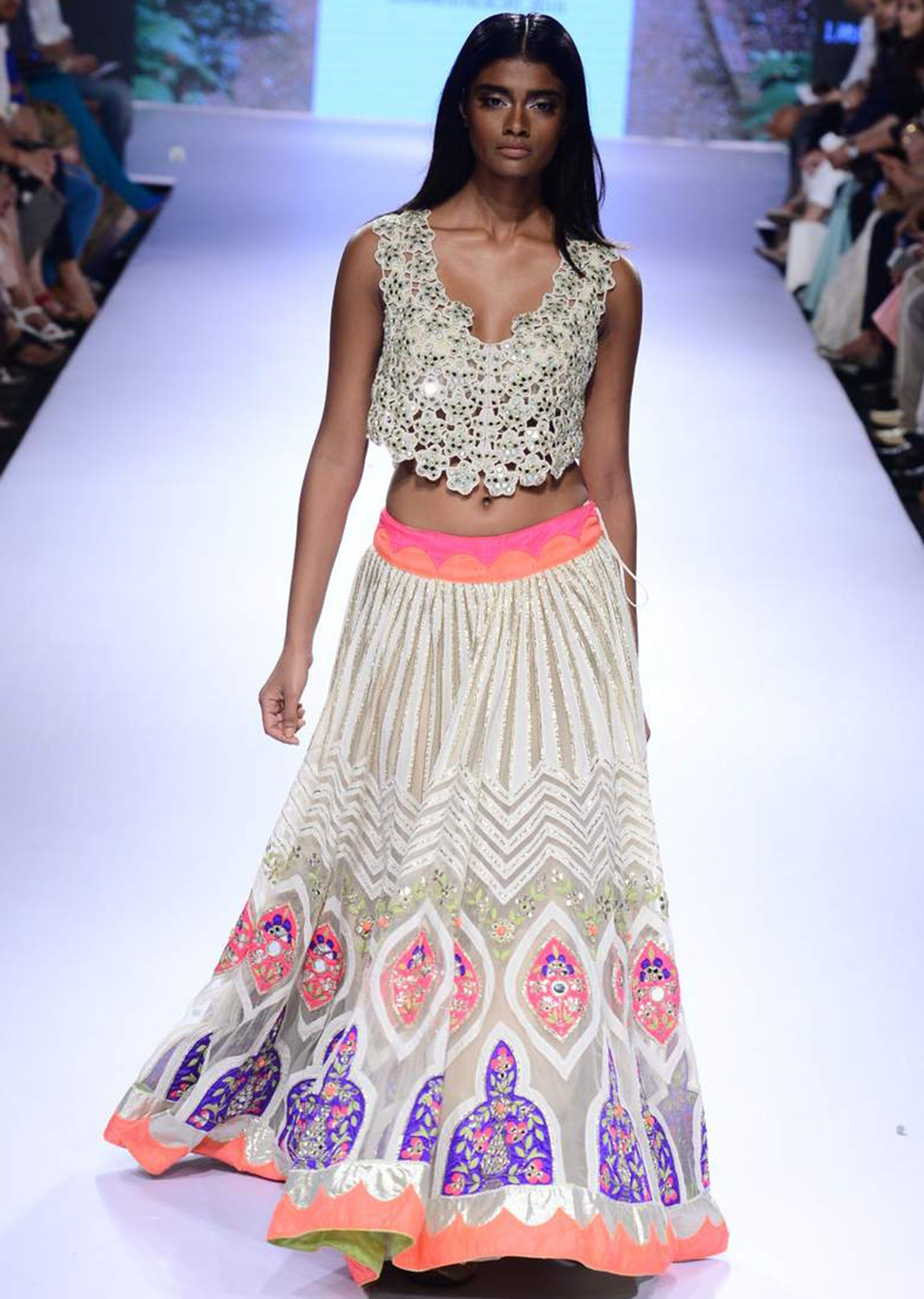 Model walks the ramp in cream embroidered lehenga with cut work blouse for Arpita Mehta's Summer Affair collection at Lakme Fashion Week Summer Resort 2015 - Kalkifashion.com