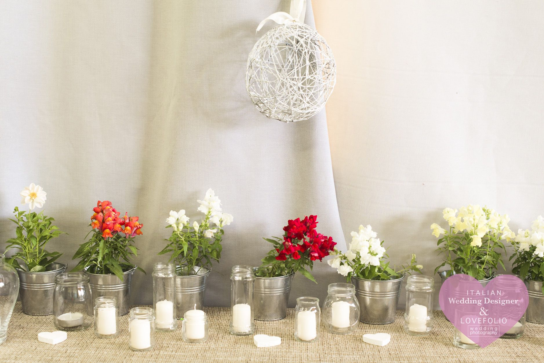 Rustic wedding buffet table: flowers, candles and burlap tablecloth ...
