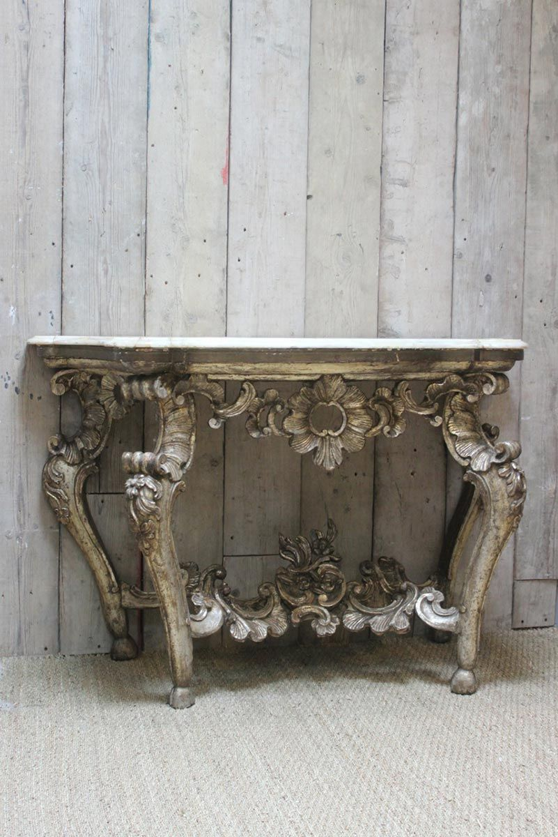 An 18th cent italian carved wood silver gilt console table an 18th cent italian carved wood silver gilt console table geotapseo Gallery
