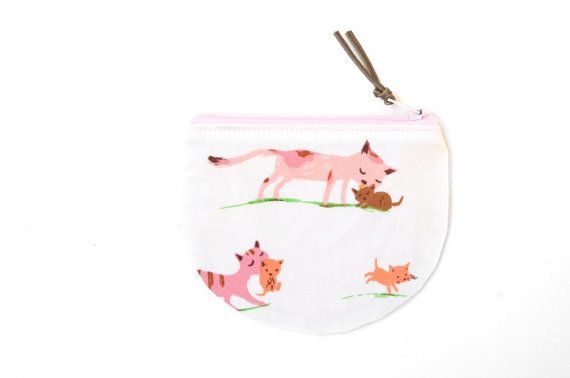 This cat coin pouch features a super cute print designed by Heather Ross, and is sure to keep all of your coins in one place! With its rounded