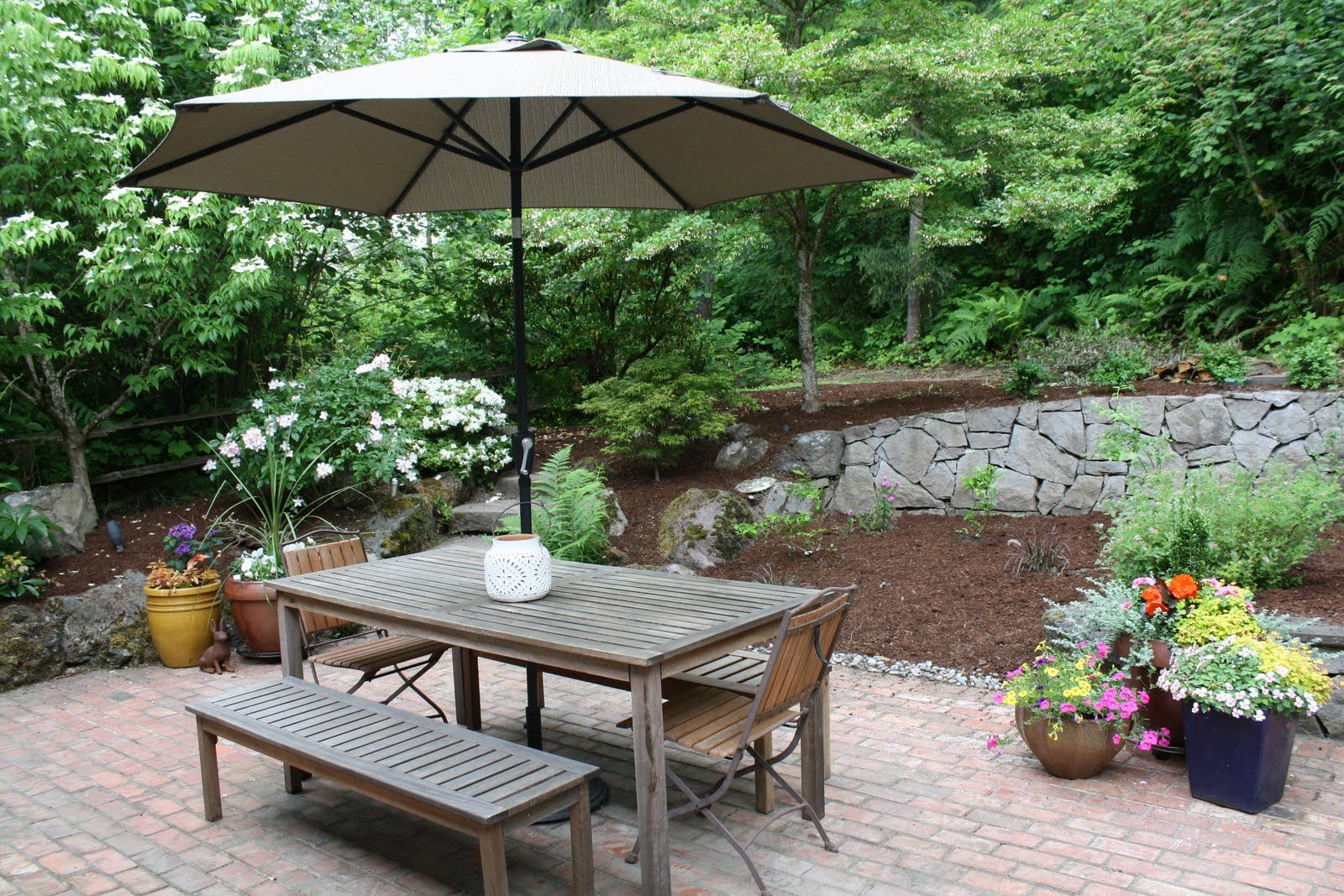 Remodeled backyard patio by Preferred Home Builders