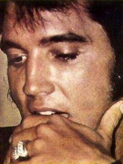 Elvis wearing his wedding band but that didn't last very long