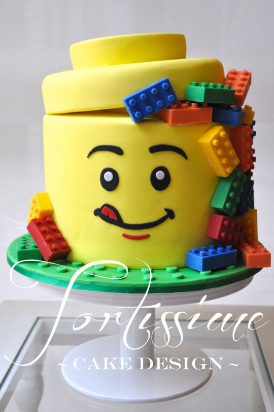 A Lego Man Head Cake With Solid Chocolate Lego Blocks Many Other