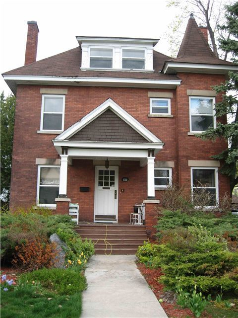 Red Brick House With White Windows Certapro Painters Painting