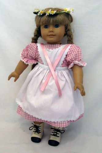 Pink checked dress with white apron to go over it. Comes with a daisy head wreath. Fits American Girl doll Kirsten, or other AG style body dolls such as Adora, My Generation, and more.  http://beabestoysandgifts.com/18-Doll-Birthday-Dress-P2632298.aspx