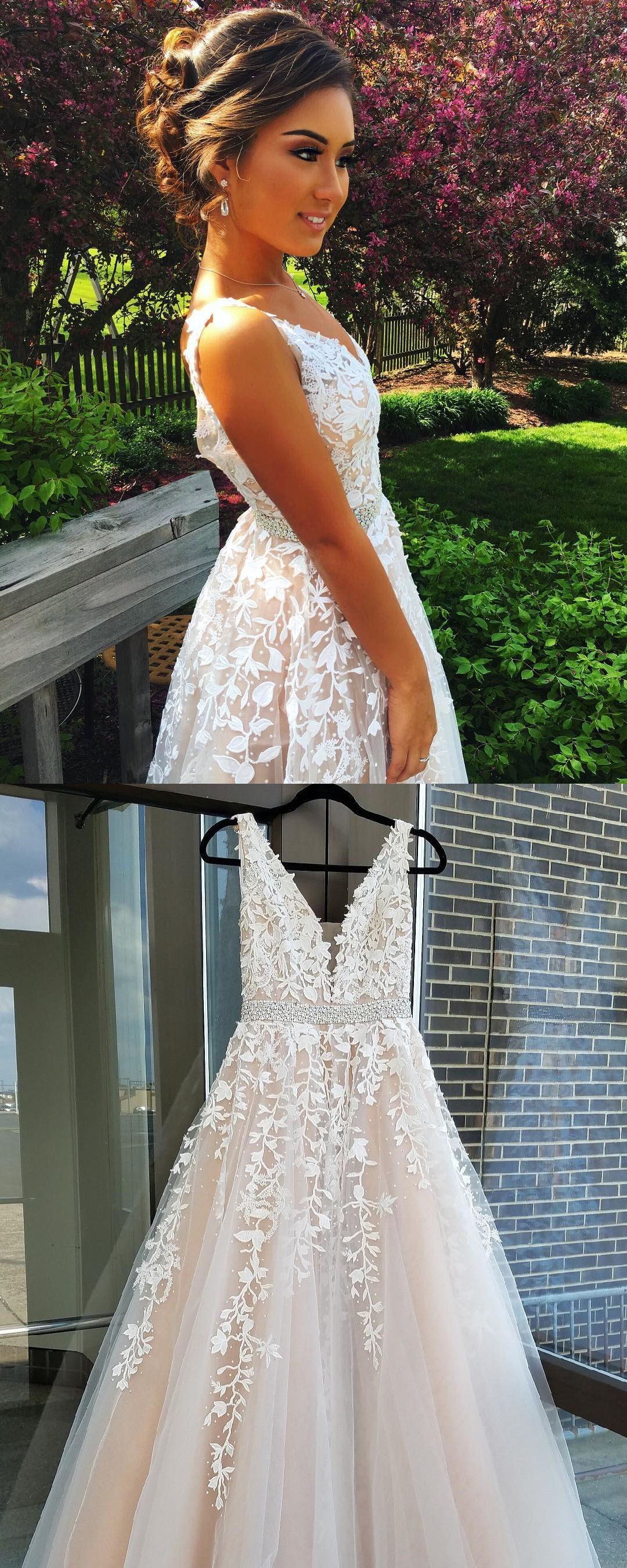 Elegant ivory beaded backless long wedding dress with appliques in