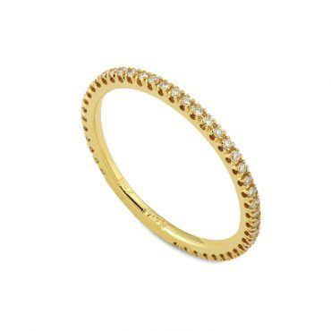 Ολόβερο δαχτυλίδι Κ18 από κίτρινο χρυσό με σειρέ διαμάντια μπριγιάν στη  βέρα του δαχτυλιδιού  a86bc6b7b58