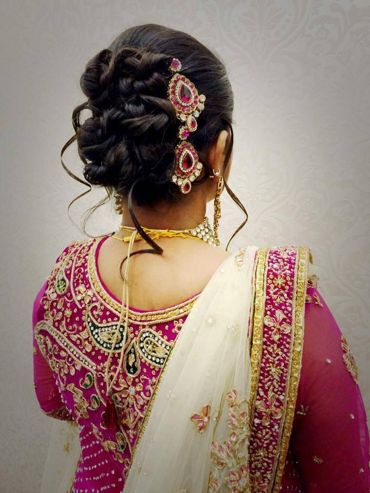 Indian bride's bridal reception hairstyle by Swank Studio. Hair accessory. Find us at https ...